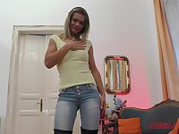 Pretty blonde in tight jeans Lara West sucks dick on her knees