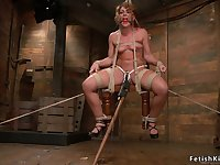 Hogtied darkhaired babe whipped and tormented