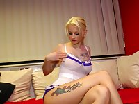 Whorish blonde Cindy is toying her stretched twat with pierced labia