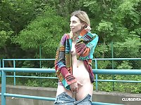 Milena Devi masturbates in the nature using her long fingers