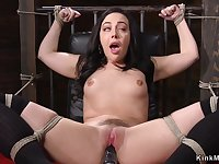 Tied up and gagged darkhaired babe fucks machine