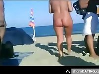 Kinky video of people sunbathing and having fun on a nudist beach