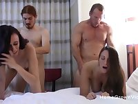 Two beautiful ladies have one hell of a time in this naughty swingers orgy.
