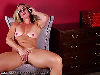 Nerdy blonde mature amateur MILF Sydney masturbates while on the phone