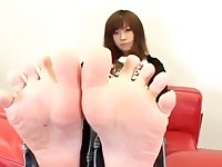 japanese woman showing her feet in jeans