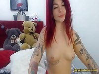 Redheaded babe that engaged to an exquisite performance live in cam