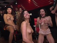 Slutty girls give it up while onlookers ogle the amazing orgy action
