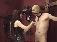 mistress in thigh high boots has helpless man in her claws