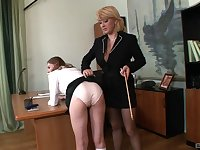 Small tits secretary Lucy Bell gets undressed and spanked